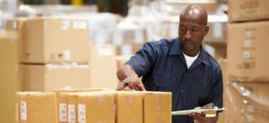 Man inspects boxes at Lancaster Packaging